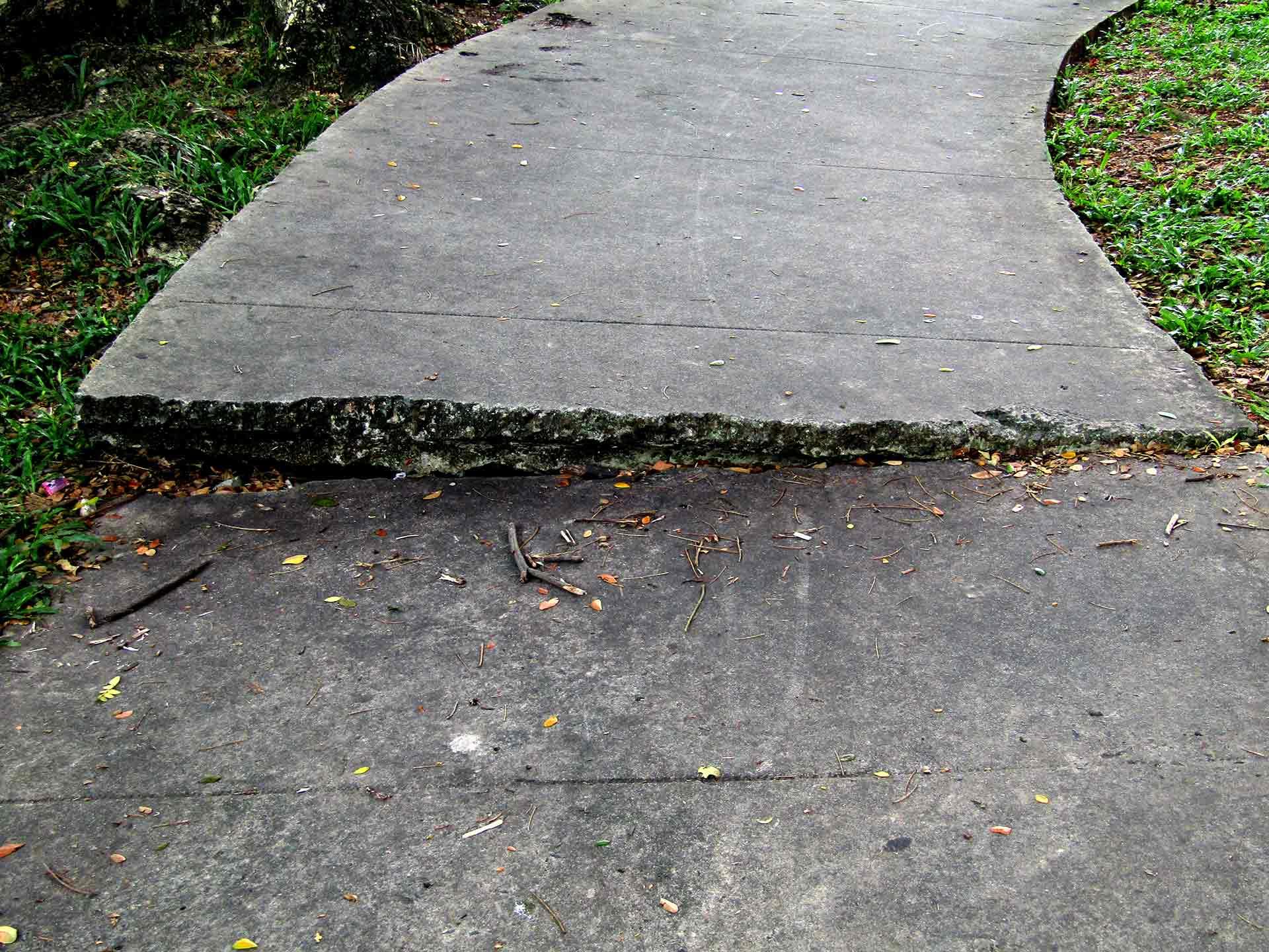 Uneven Sidewalk - Damaged